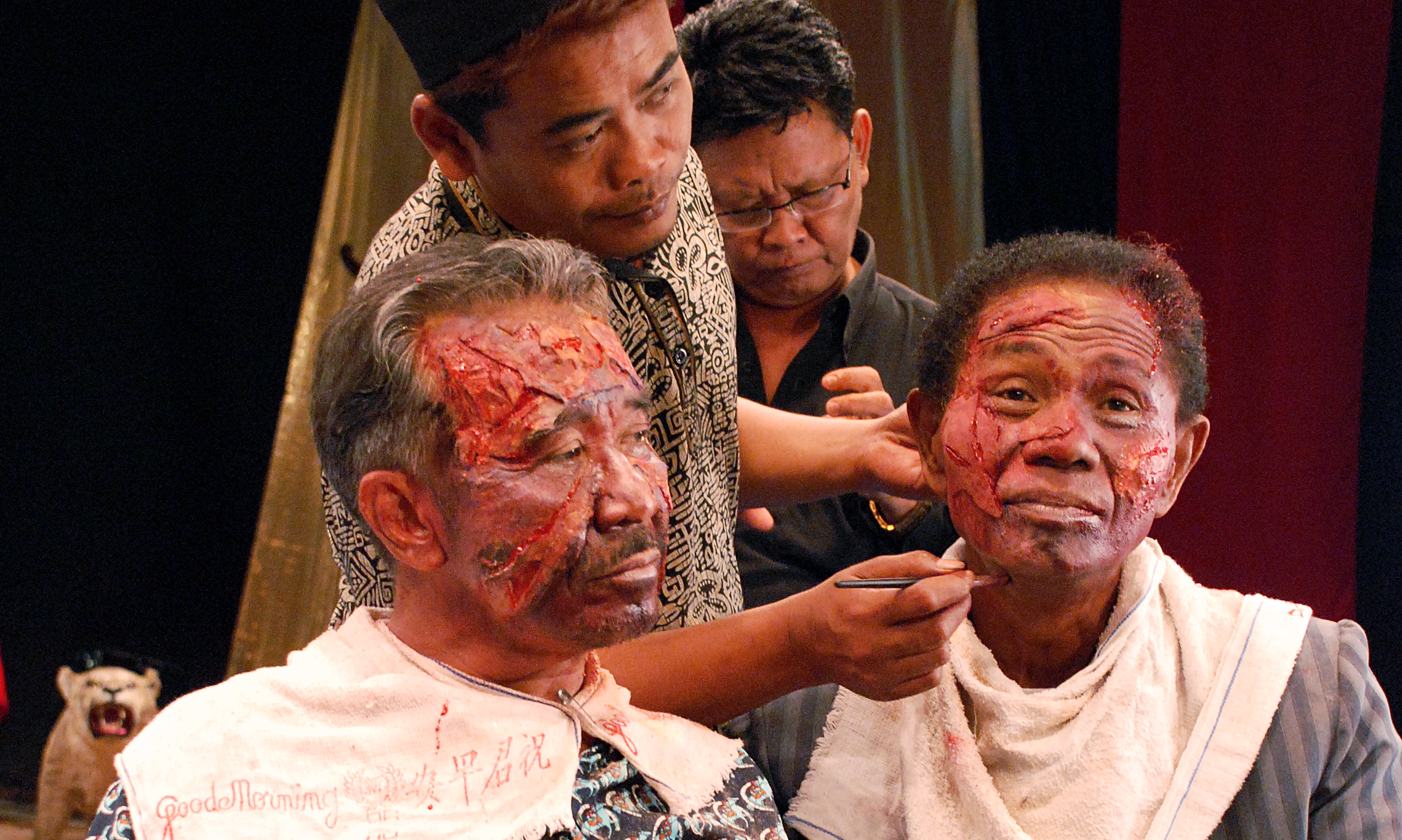 Preparing for a reenactment scene from Drafthouse Film's documentary, The Act Of Killing